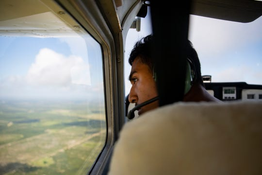 Immokalee High School sophomore Eduardo Garcia pilots a small Cessna airplane during a flight training exercise, Saturday, May 4, 2019, over Immokalee.