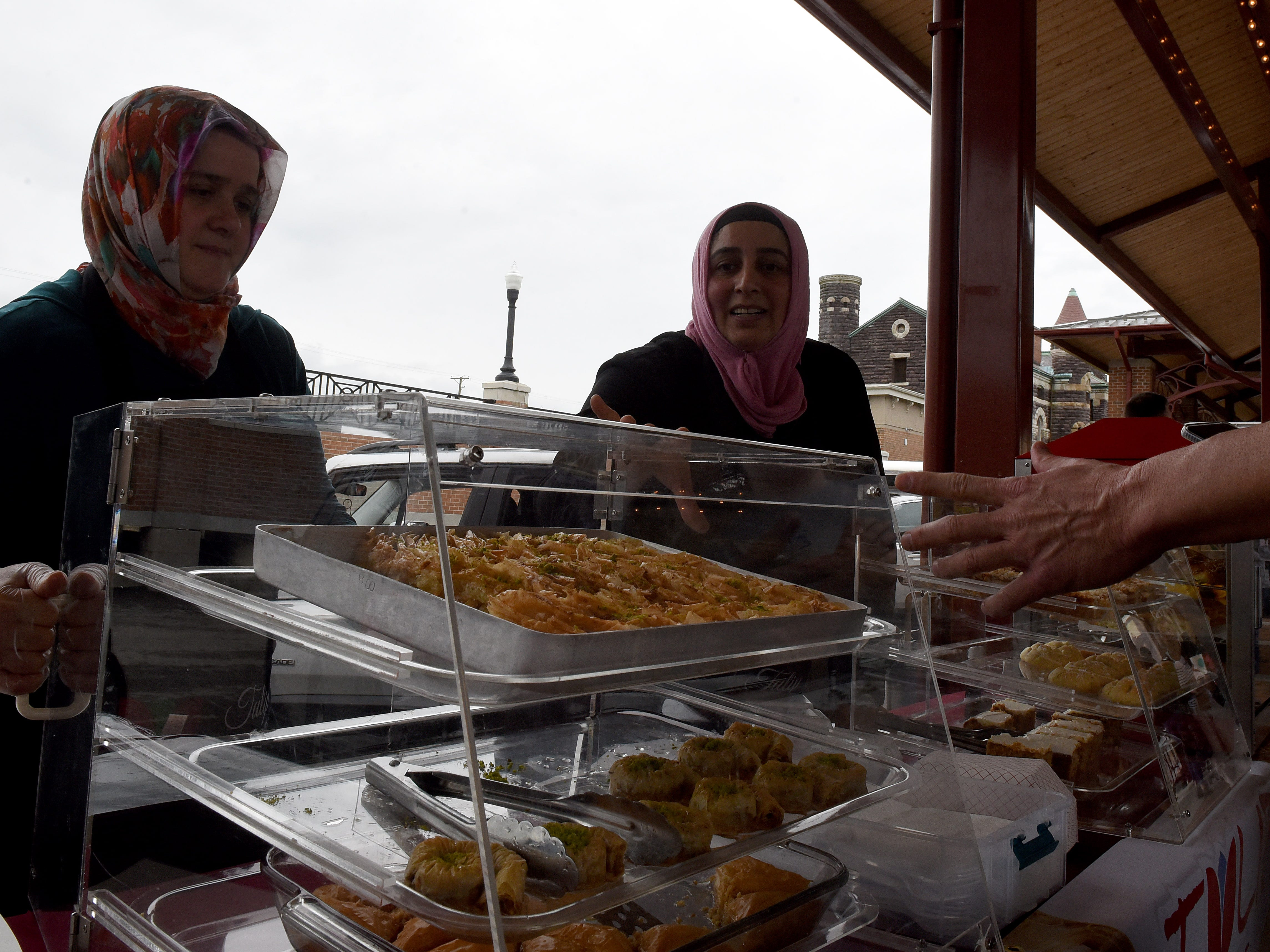 Hanife Evliyaoglu and Hatch Kucuker sell baklava and other Turkish foods and deserts with Tulip Cafe during The Canal Market District's kicked off for its fourth season on Friday, May 3, 2019.