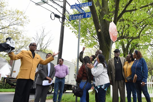Edward Pazant, a well-known jazz musician who lived in Teaneck, gets a road named after him in a ceremony in Teaneck on Saturday May 4, 2019. James Scott (left) unveils the new street sign.