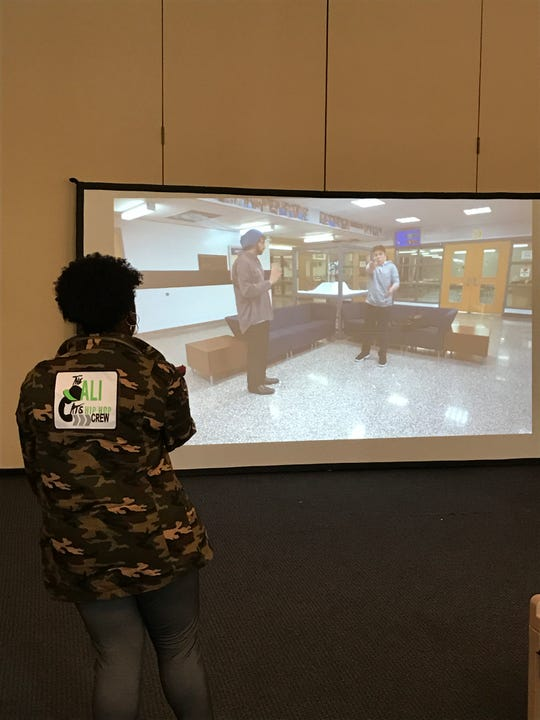 A Bergen middle-schooler approaches an active shooter in a virtual reality simulation.