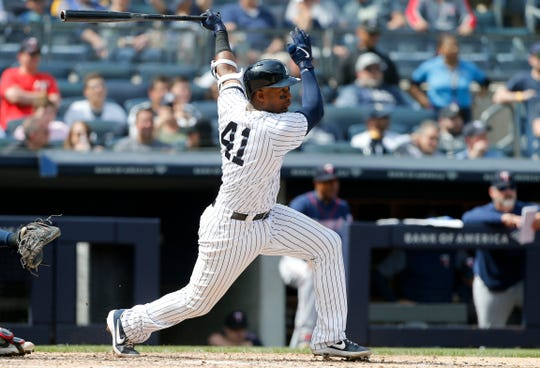 Miguel Andujar #41 of the New York Yankees follows through on a sixth inning single against the Minnesota Twins at Yankee Stadium on May 04, 2019 in New York City.