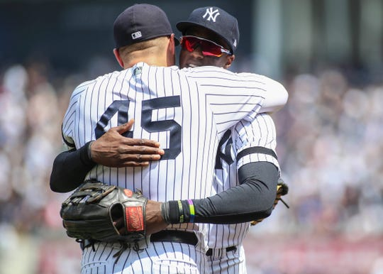 May 4, 2019; Bronx, NY, USA; New York Yankees right fielder Cameron Maybin (38) is greeted by first baseman Luke Voit (45) after making a leaping catch to end the fourth inning against the Minnesota Twins at Yankee Stadium.