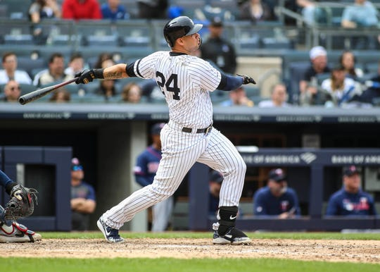 May 4, 2019; Bronx, NY, USA; New York Yankees designated hitter Gary Sanchez (24) hits a solo home run in the eighth inning against the Minnesota Twins at Yankee Stadium.
