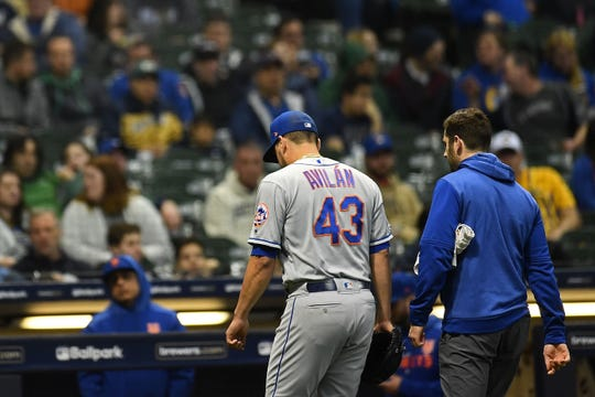 Luis Avilan of the New York Mets leaves the game during the eighth inning against the Milwaukee Brewers at Miller Park on May 03, 2019 in Milwaukee, Wisconsin.