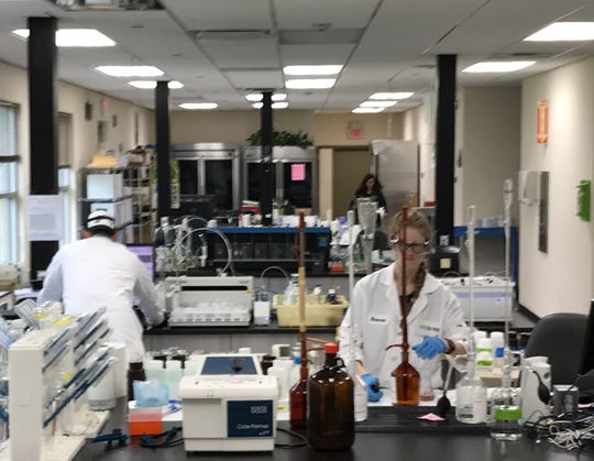Workers at Suez's laboratory in Haworth testing water samples on May 2, 2019.