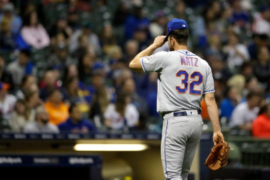 New York Mets' Steven Matz adjusts his cap after being taken out of the game against the Milwaukee Brewers during the sixth inning Friday, May 3, 2019, in Milwaukee.