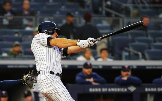 May 3, 2019; Bronx, NY, USA; New York Yankees left fielder Brett Gardner (11) swings and reaches on a three base error against the Minnesota Twins during the first inning at Yankee Stadium.