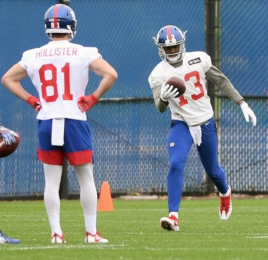 Former Monmouth star wide receiver Reggie White Jr. (13) makes a one-handed catch as wide receiver Cody Hollister (81) looks on during New York Giants Rookie Minicamp at the Quest Diagnostics Training Center on Friday, May 3, 2019.