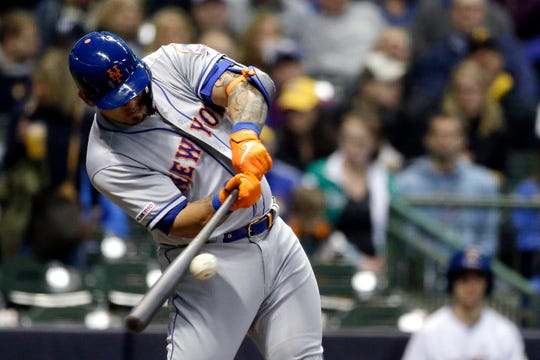 New York Mets' Wilson Ramos hits an RBI single during the first inning of the team's game against the Milwaukee Brewers on Friday, May 3, 2019, in Milwaukee.