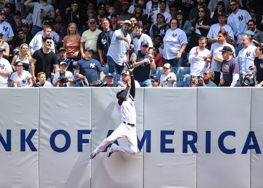 May 4, 2019; Bronx, NY, USA; New York Yankees right fielder Cameron Maybin (38) makes a leaping catch against the Minnesota Twins in the fourth inning at Yankee Stadium.
