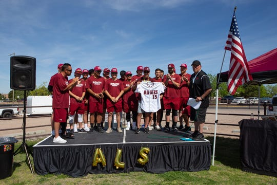 New Mexico State baseball alum Todd Watkins receives a signed jersey from the Aggie baseball team. Watkins was the guest of honor at the 2019 Walk to Defeat ALS held at Lou and Pat Sisbarro Park on the NMSU campus on Saturday.