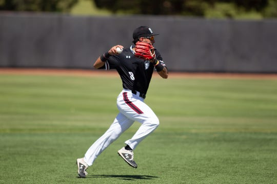 New Mexico State's Joey Ortiz looks to throw to first against Texas Rio Grande Valley on Saturday at Presley Askew Field.