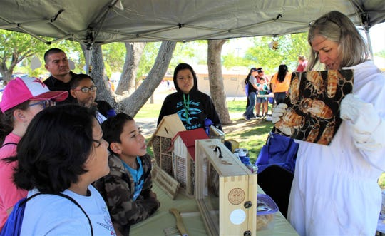 Jill Kindrick told children attending the Las Cruces Utilities Water Festival about the queen bee and asked kids to try to find her in the observation hive.