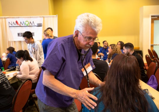 Bryan Ramkey, a registered nurse, listens to a patient's heart Saturday, May 4, 2019, at the Las Cruces Convention Center during the New Mexico Mission of Mercy free dental care clinic.