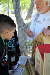 Bob Reneau, president of the Paseo del Norte Beekeepers Association, brought an observation hive filled with live bees and spoke to fourth-grade students at the Las Cruces Utilities Children's Water Festival explaining that bees are in trouble. Bee populations in the U.S. are down more than 40% since 1947.