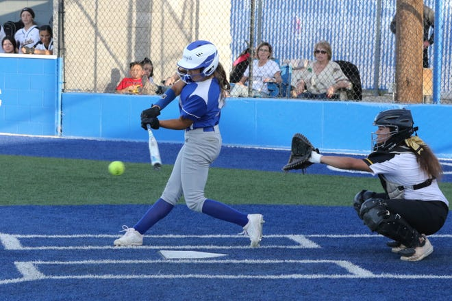 Carlsbad's Gabby Aragon connects with a pitch during Friday's doubleheader against Hobbs.