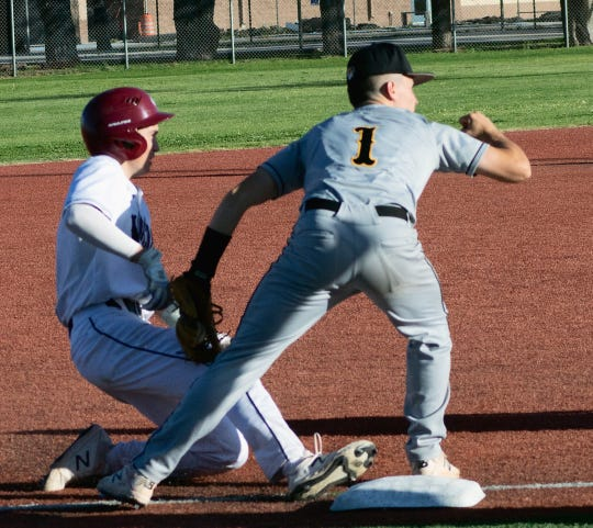 """With a fist pump and his glove still in contact with Deming Wildcat Creighton Apodaca, Alamogordo Tiger Evan Best is confident Apodaca will be declared, """"out,"""" which he was."""