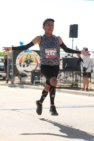 Kyle Sumatzkuku of Tuba City, Arizona, wins the 2019 Shiprock Marathon men's title with a time of 2 hours, 38 minutes and 8 seconds on Saturday.
