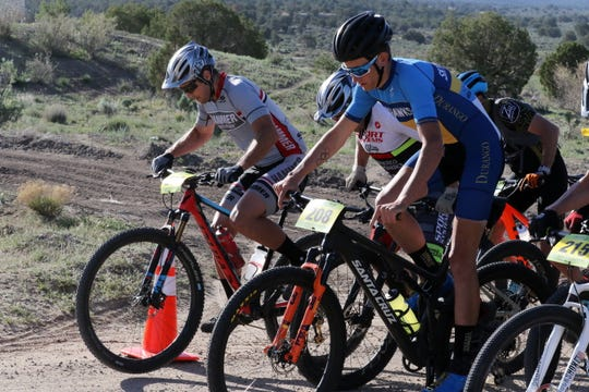 Bicyclists start the Alien Run Mountain Bike race, Saturday, May 4, 2019, near Aztec.