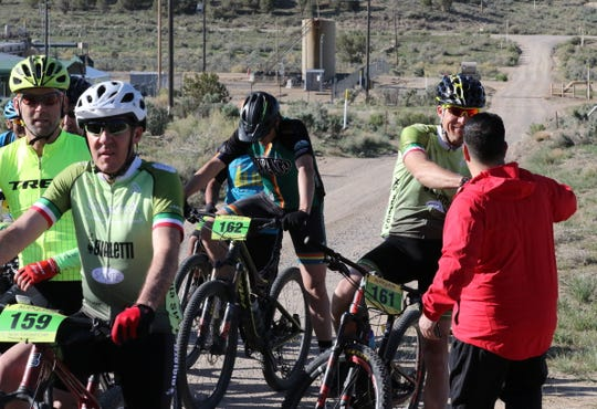 U.S. Rep. Ben Ray Lujan, D-NM, greets a participant in the Alien Run Mountain Bike Race, Saturday, May 4, 2019, near Aztec.