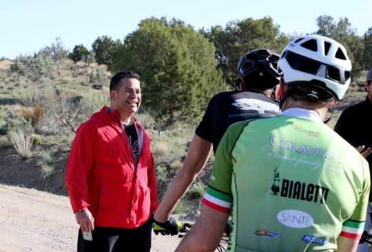 U.S. Rep. Ben Ray Lujan, D-NM, speaks to participants in the Alien Run Mountain Bike Race, Saturday, May 4, 2019, near Aztec.