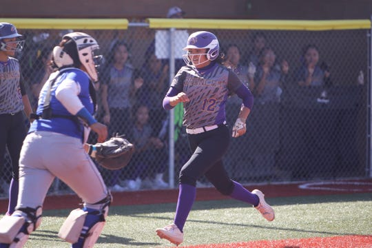 Kirtland Central's Brianna Switzler scores a run against Bloomfield during Friday's District 1-4A game at Bloomfield Softball Complex.
