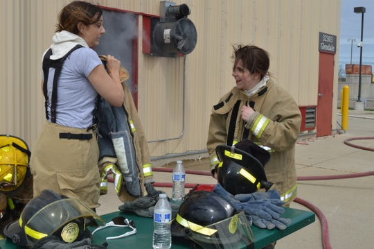 State Sen. Dayna Polehanki, left, and state Rep. Laurie Pohutsky chat after a Fire Ops 101 drill on Saturday, May 4, 2019.