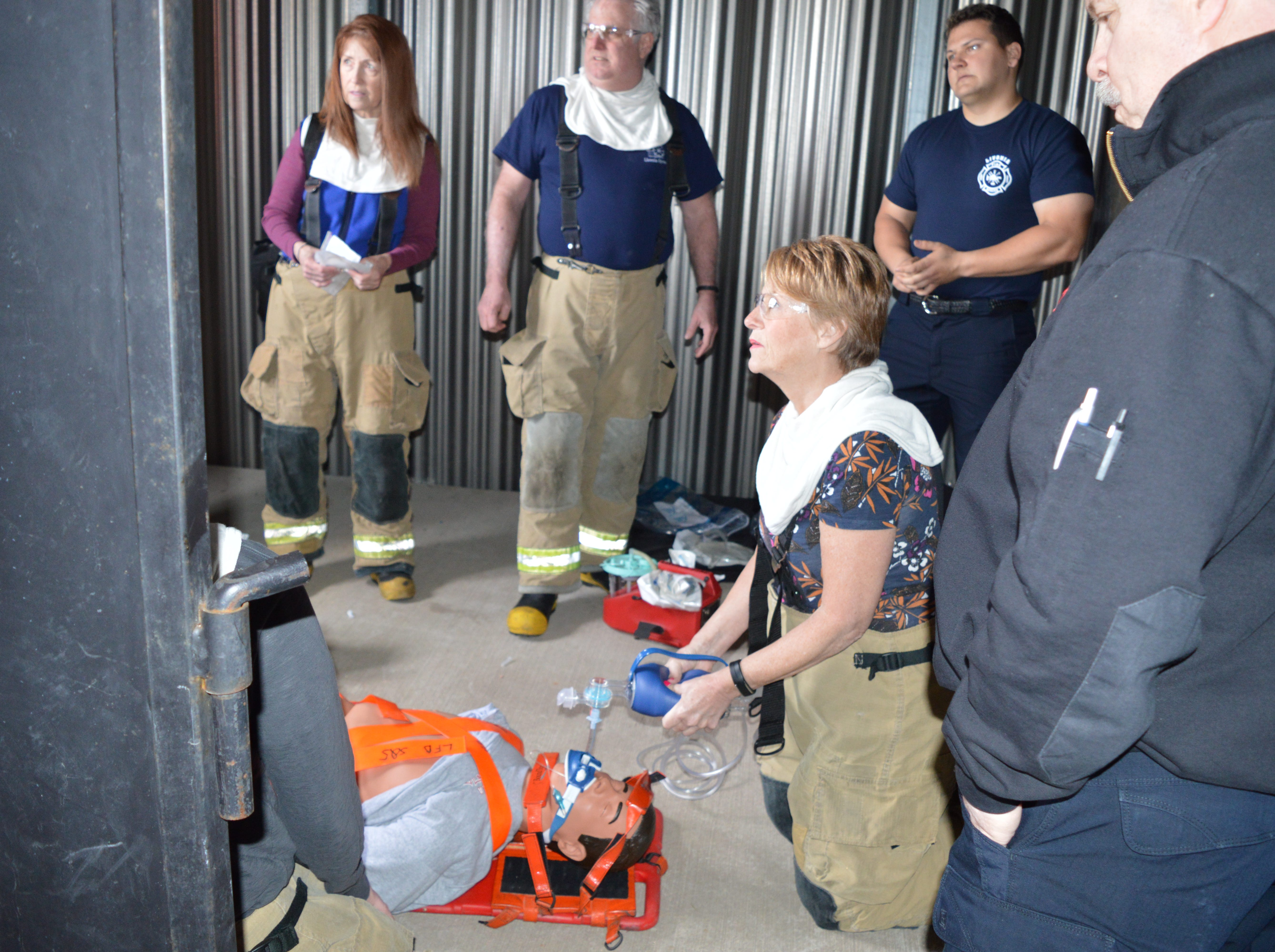 Denise Maier, Livonia's human resources director, participates in a Fire Ops 101 drill while listening to one of her local firefighters on Saturday, May 4, 2019.