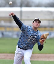Livonia Stevenson Spartan Nate Waligora pitches some warm-up during his team's May 3 game against Plymouth High.