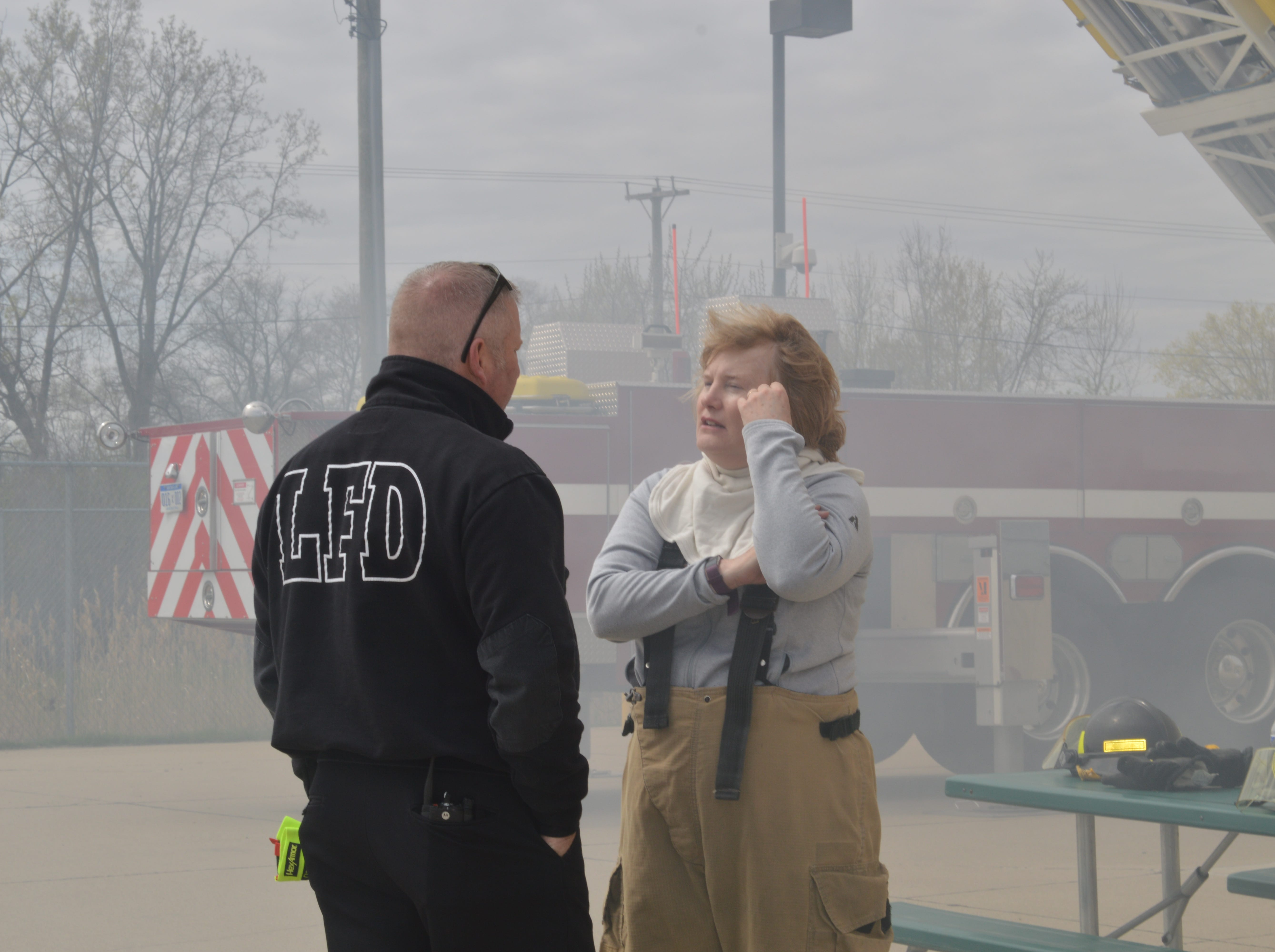 Livonia Fire Chief Dave Heavener and Councilwoman Kathleen McIntyre chat during a Fire Ops 101 event on Saturday, May 4, 2019.