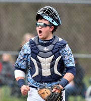 Spartan catcher Bobby Cavin is pumped up after his teammates get out of a tough fifth inning against Plymouth on May 3.