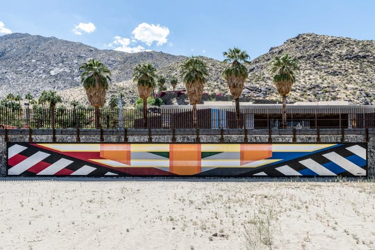"Ryan Campbell's ""Line Segments"" is one of the eight murals inspired by the anniversary, located in the 'pit,' between the Rowan Hotel and the Palm Springs Art Museum."