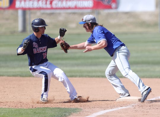 Sakemi Sato of La Quinta is tagged out at first base against Temescal Canyon, May 3, 2019.