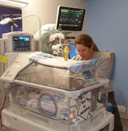 """Nurse Kristen Farinas cares for Wyatt Hale on May 4, 2019, at the Neonatal Intensive Care Unit, now renamed """"Pediatrix Medical Group, an affiliate of Mednax"""" at the Studer Family Children's Hospital. Pediatrix Medical Group donated $2.5 million to the NICU on Thursday."""