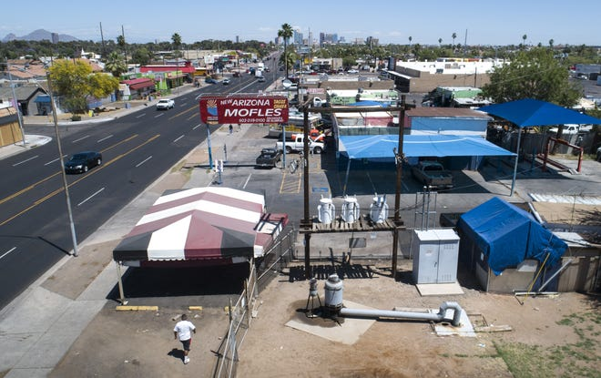 One of the Roosevelt Irrigation District's wells (bottom center) sits next to an auto shop at Van Buren Street and 28th Drive in Phoenix.
