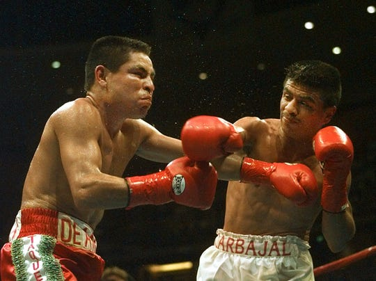 Michael Carbajal, right, of Phoenix, Ariz., lands the knockout punch to the head of Tomas Rivera, from Mazatlan, Mexico, during the fourth round of their IBF Light Flyweight Championship fight at the Arrowhead Pond of Anaheim, Saturday, Oct. 12, 1996, in Anaheim, Calif.  Carbajal retained his title by knocking out Rivera in the fourth round.