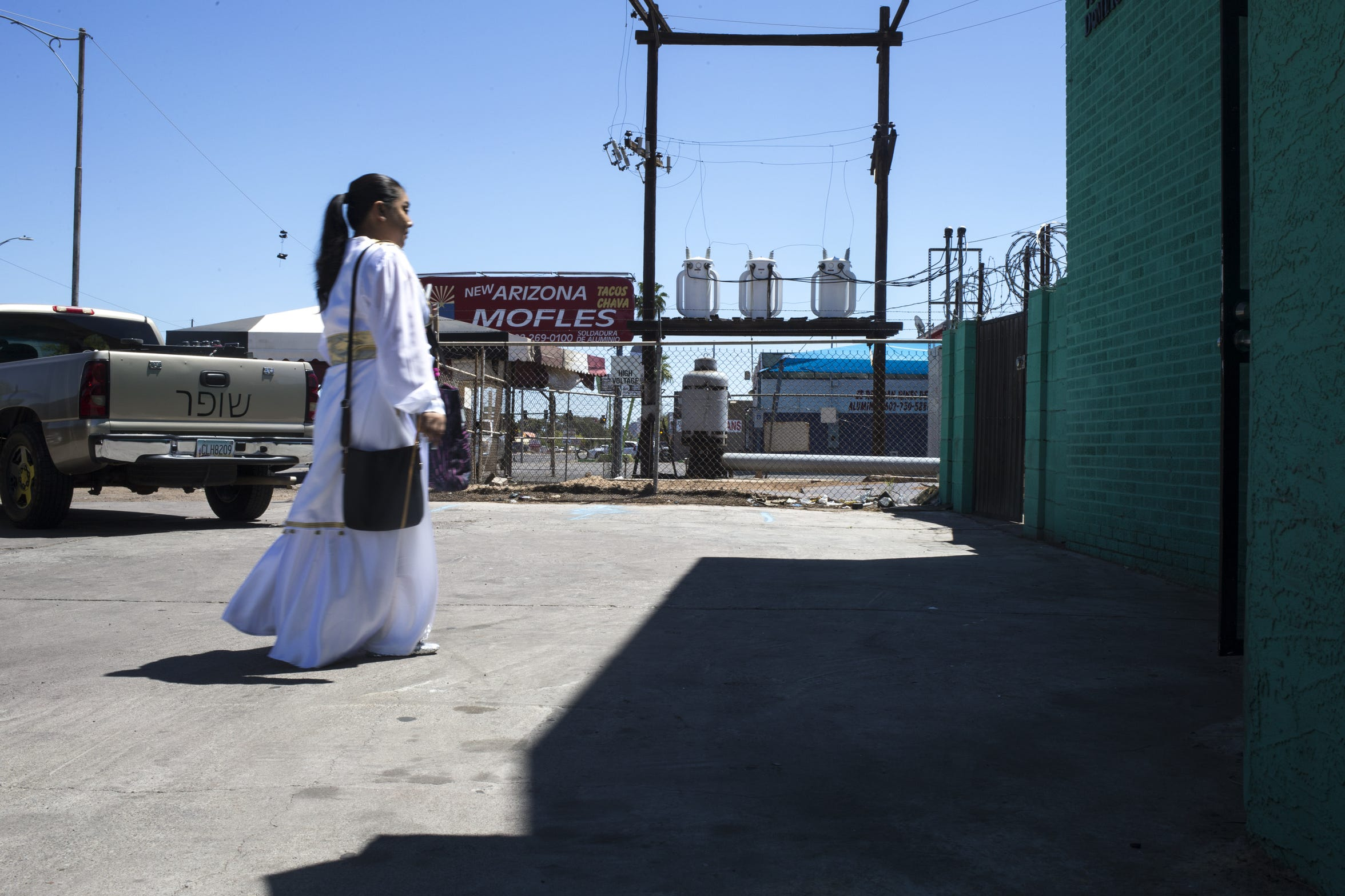 A worshiper enters Templo Agua Viva church for Easter services on April 21, 2019. A well stands in the background next to West Van Buren Street.