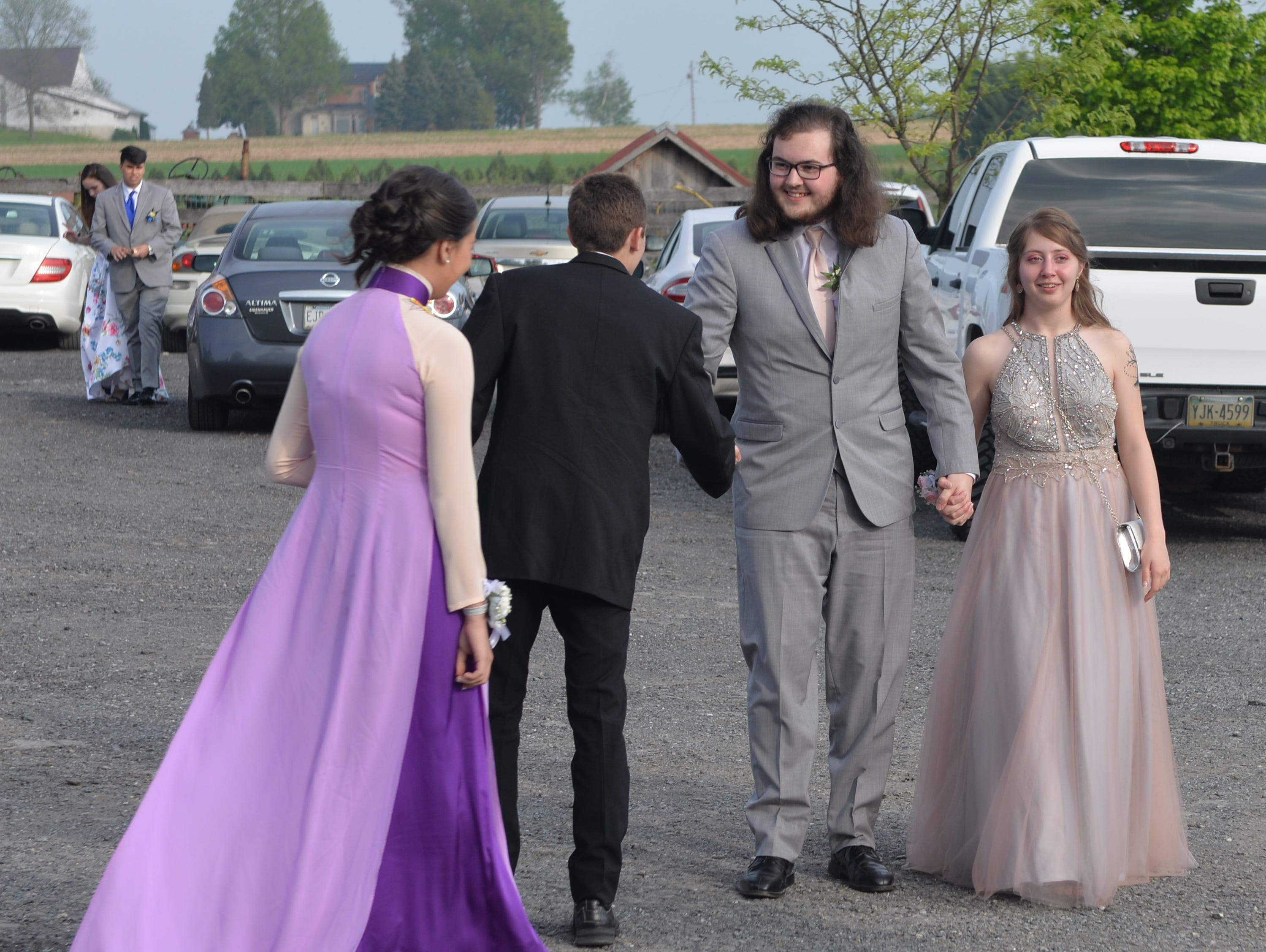 Students and their guests arrive at the Country Loft Barn in Lancaster, Friday, May 3, 2019 for the Cedar Crest prom.