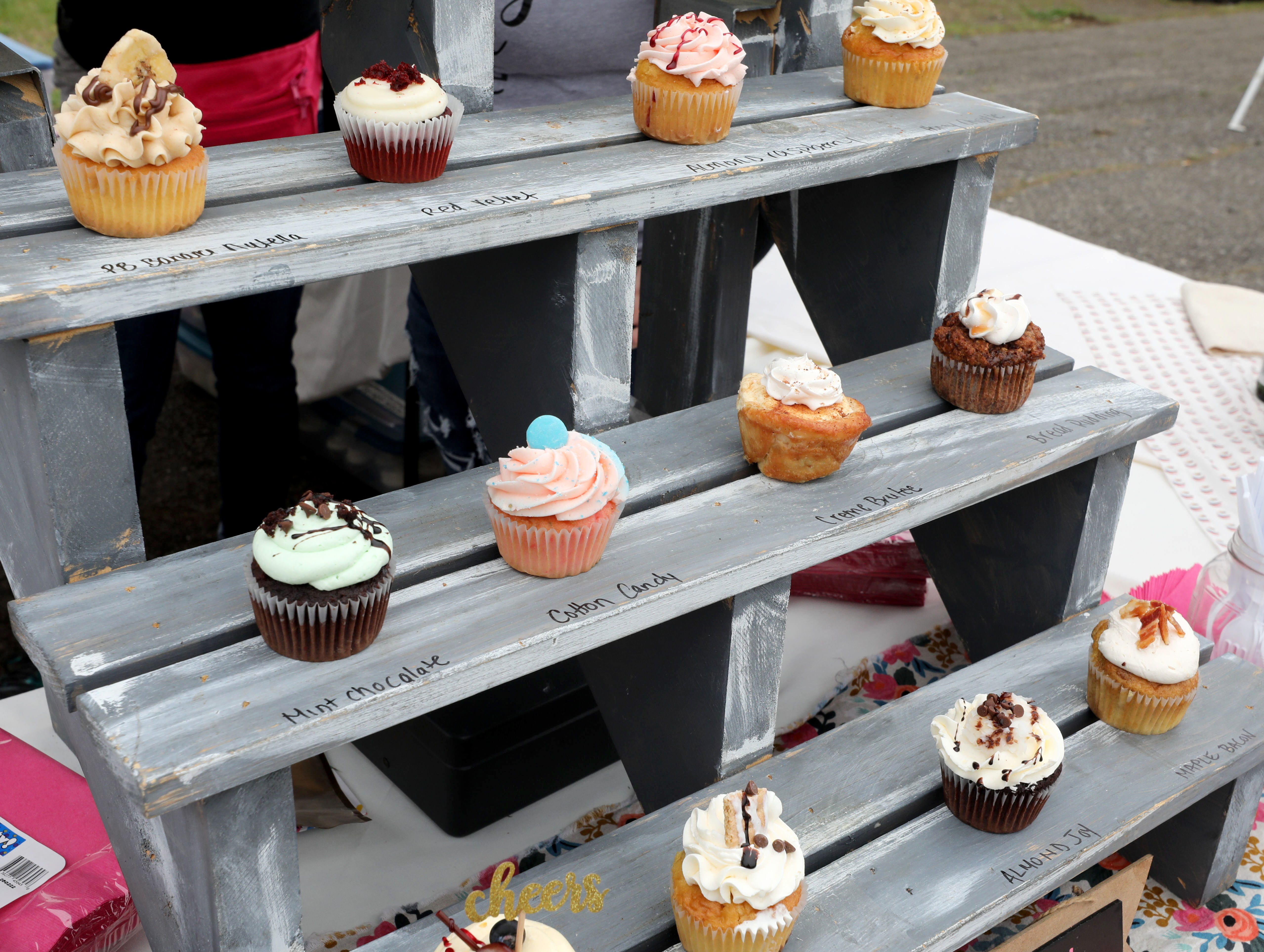 Cupcakes on display from the Eat This Bakery And Gifts booth, during the K104.7 Cupcake Festival at the Stormville Airport, May 4, 2019.