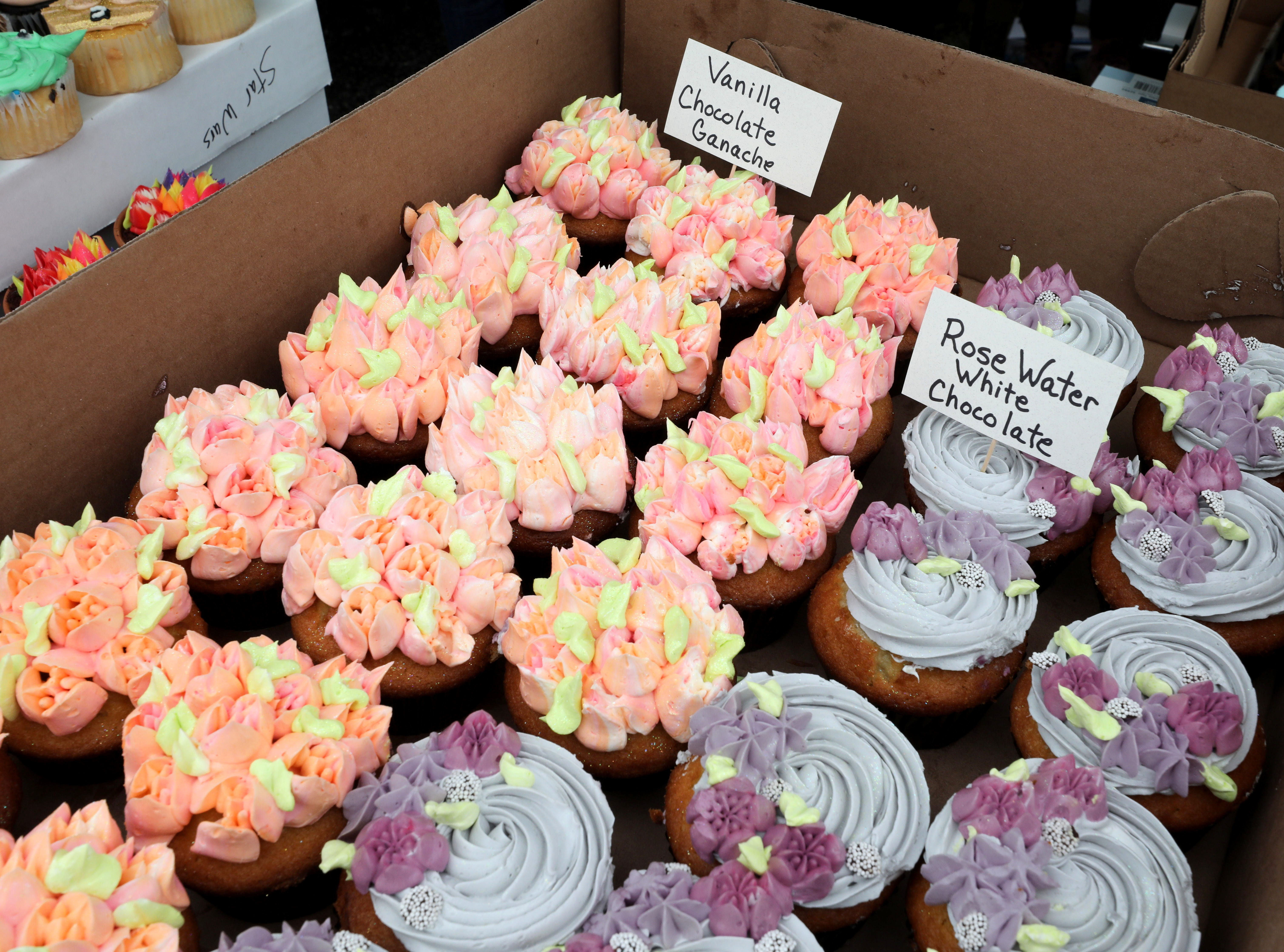 Beautifully decorated cupcakes from the Adam's Fairacre Farms booth are pictured during the K104.7 Cupcake Festival at the Stormville Airport, May 4, 2019.