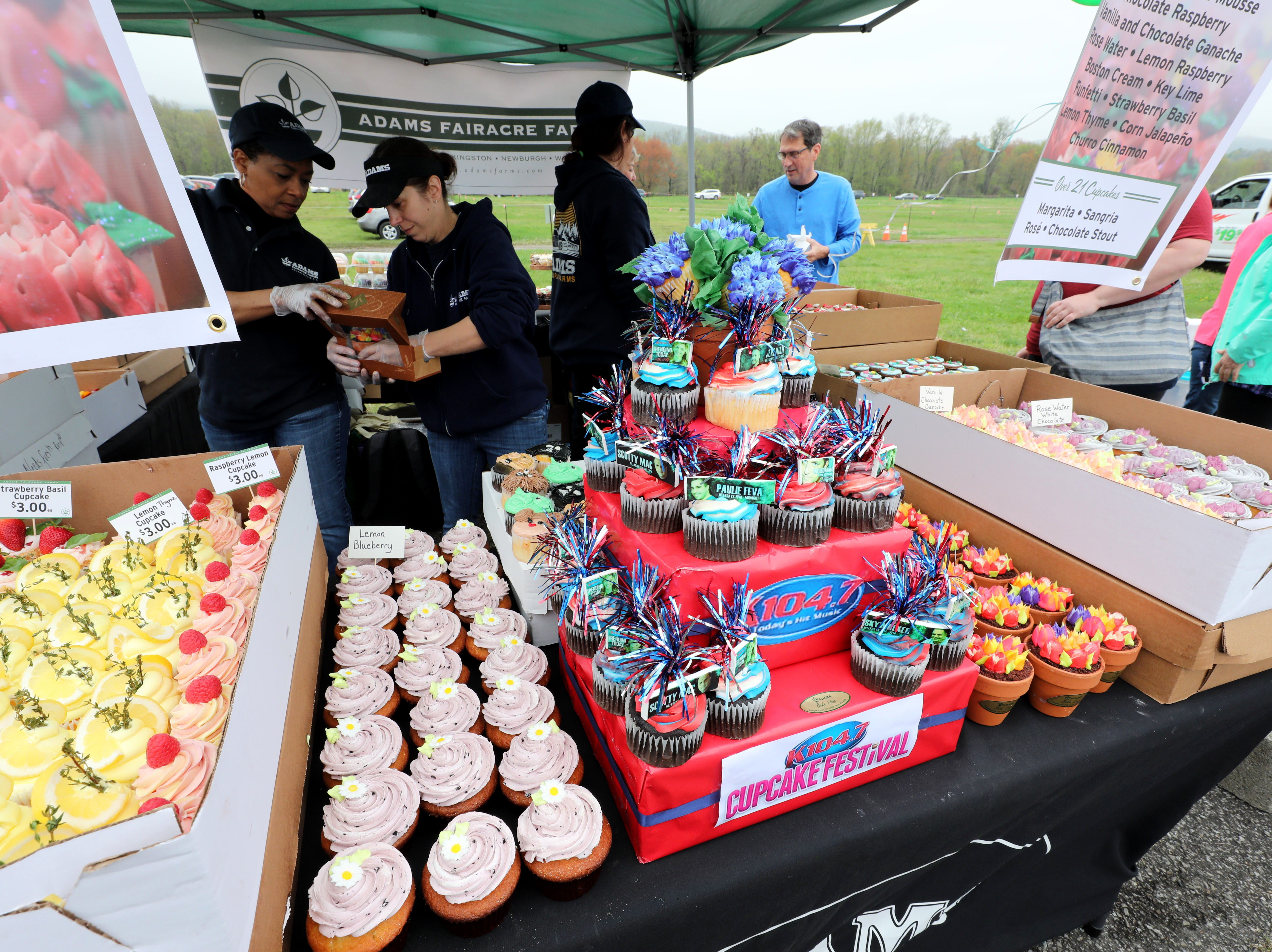 A variety of cupcakes at the start of the festival are pictured at the Adam's Fairacre Farms booth, during the K104.7 Cupcake Festival at the Stormville Airport, May 4, 2019.