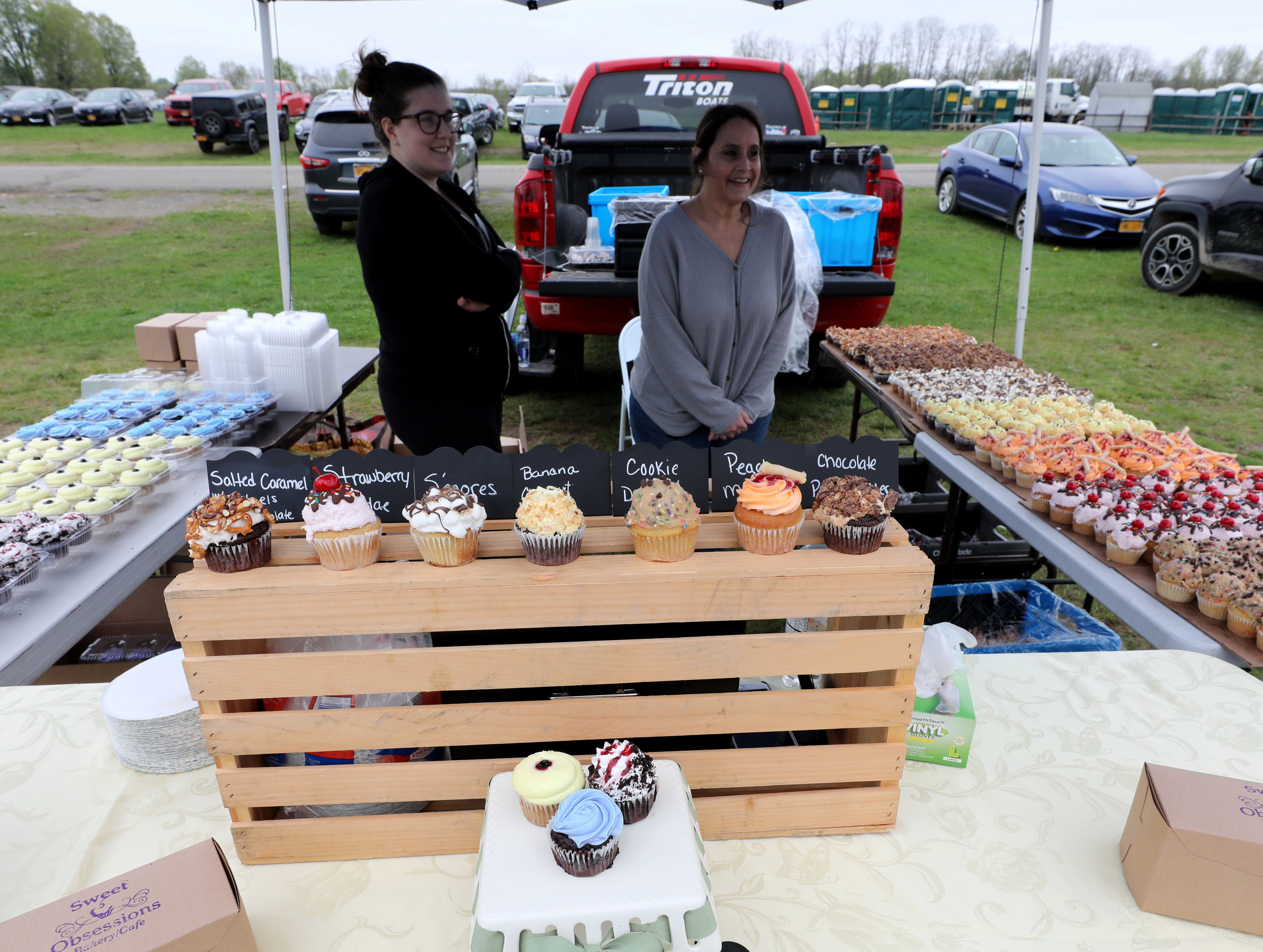 The Sweet Obsessions booth is pictured during the K104.7 Cupcake Festival at the Stormville Airport, May 4, 2019.