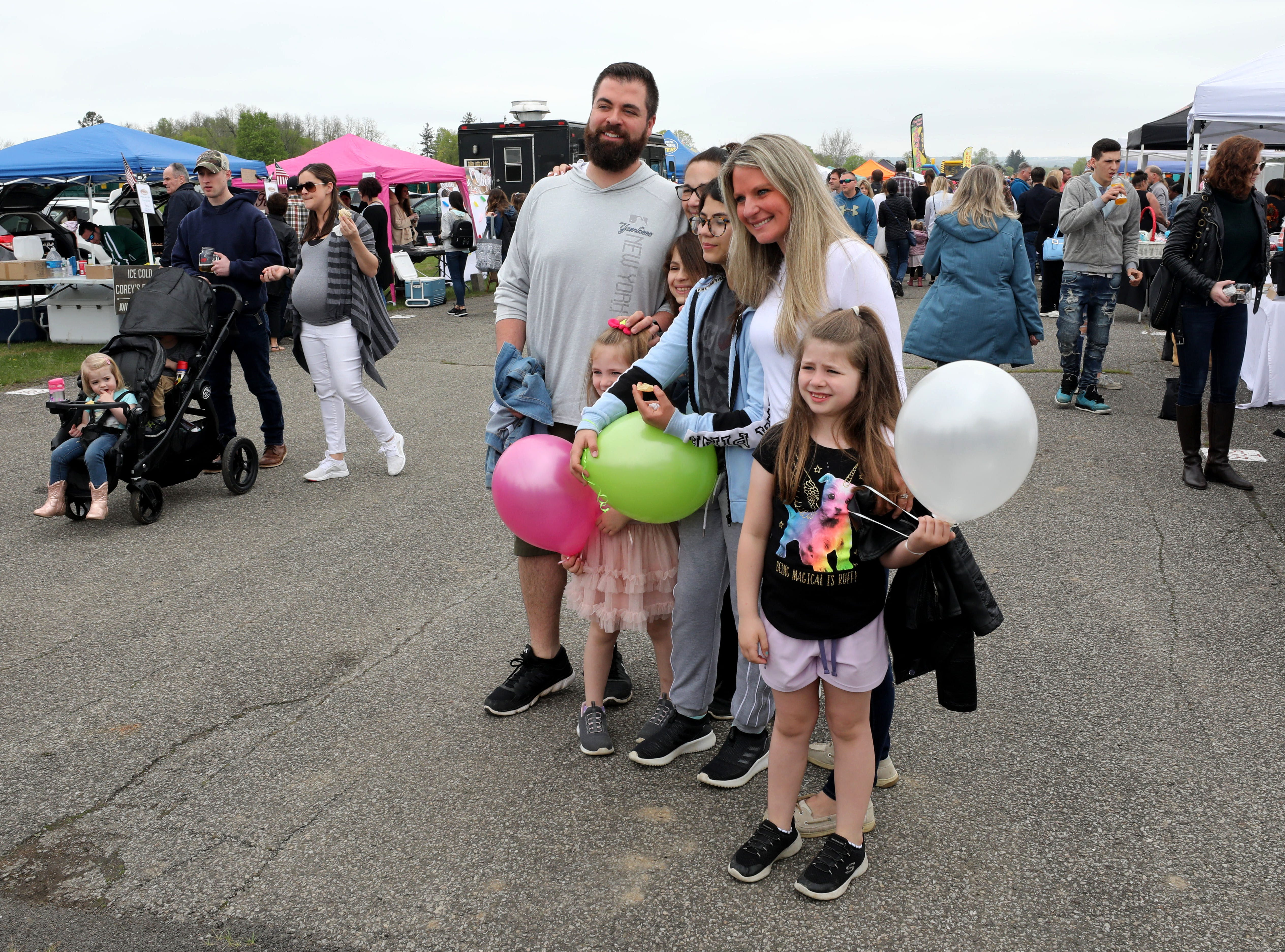 Festival goers pose for photos during the K104.7 Cupcake Festival at the Stormville Airport, May 4, 2019.