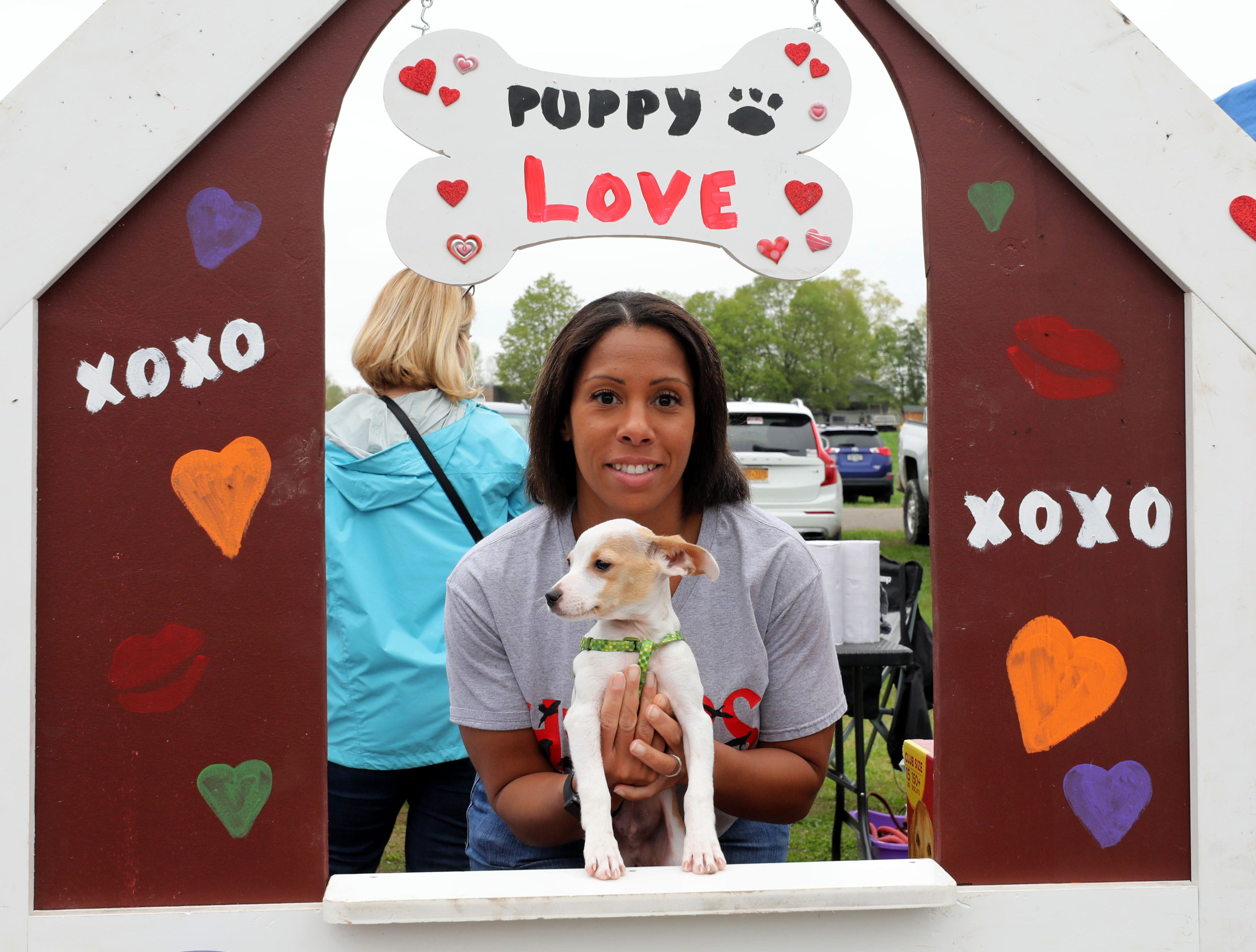 Marjorie Coon is pictured with 3-month old Rufus at the Hudson Valley Animal Rescue and Sanctuary booth during the K104.7 Cupcake Festival at the Stormville Airport, May 4, 2019.