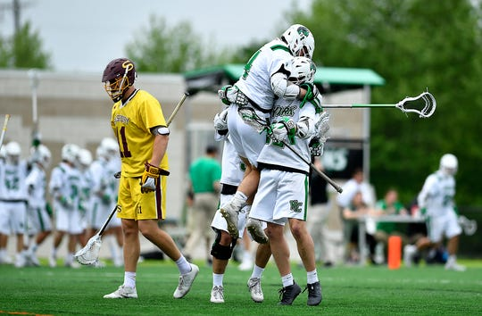 The York College men's lacrosse team celebrates a goal during a recent game against Salisbury. The York men's team is ranked No. 4 nationally in NCAA Division III.