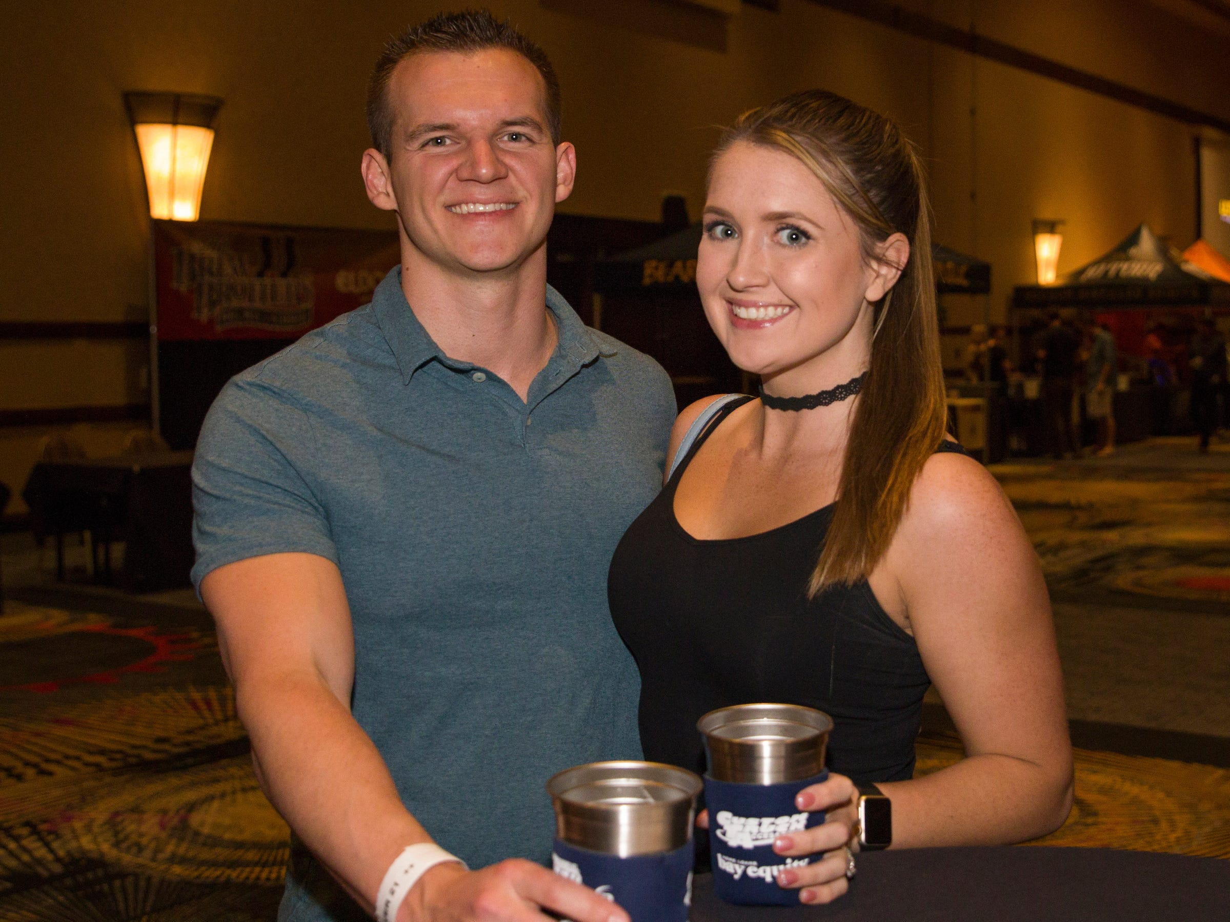 Zack and Bella Romos during the Young Alumni Beer Fest in the Reno Ballroom in downtown Reno on Friday, May 3, 2019.