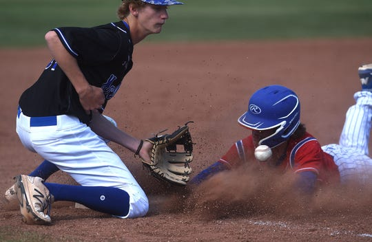 Reno's Drue Worthen (5) slides safely into third base while taking on McQueen during their baseball game at McQueen on May 1, 2019.