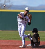 Bishop Manogue's Josh Rolling throws to first base to get the double play as Galena's Dean Aduddell slides into second base on April 16, 2019.