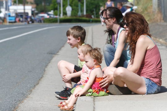 Boomtown Festival parade spectators, from left to right, Aidan McLelland, Royal Crisel, Dally Haden, Georgia Crisel and Cassie Armstead watch a float go down Shasta Dam Boulevard on Saturday, May 4, 2019.