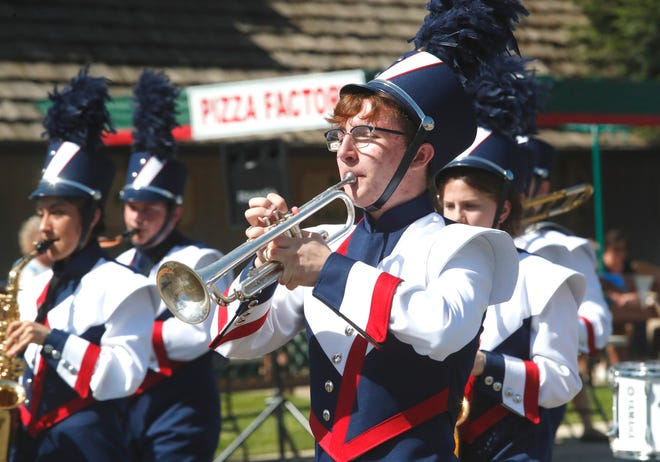 Julian Durr of the Central Valley High School Marching Band plays trumpet during the Boomtown Festival parade along Shasta Dam Boulevard on Saturday, May 4, 2019.